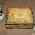 Step 3 - The box covered in paper which has been inked and then the edges were painted