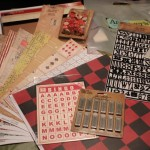 Papers and embellishments for letterblock tray