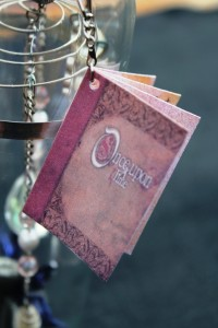"A small book (about 1"" x 1.5"") tells the story of Brillare - the pixie that loves to collect things that sparkle."