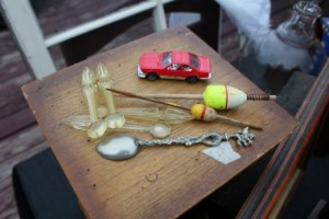 A Matchbox car, wooden bobbers, a small silver spook with a griffin on top,...