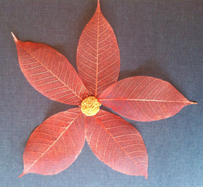 Skeleton leaves painted with Tomato Pearl Perfect Pigment and Heart of Gold prills