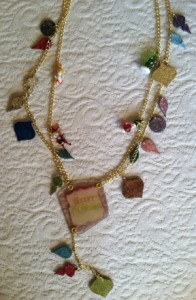 Finished necklace made with chipboard ornaments, Mica Tiles, and Mica D'Lights