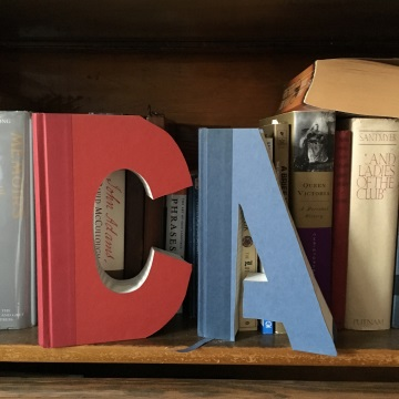 Initials cut from books